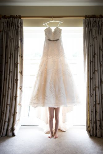 Flower girl tries on wedding dress - Kent wedding photographer