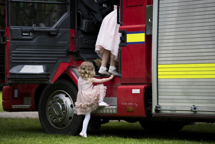 Children climb into a fire truck at Marleybrook House wedding venue in Kent