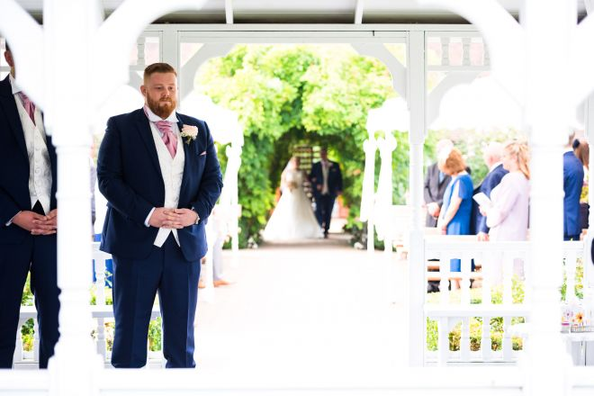 a nervous groom at the Old Kent Barn - Scott Kendall Photography