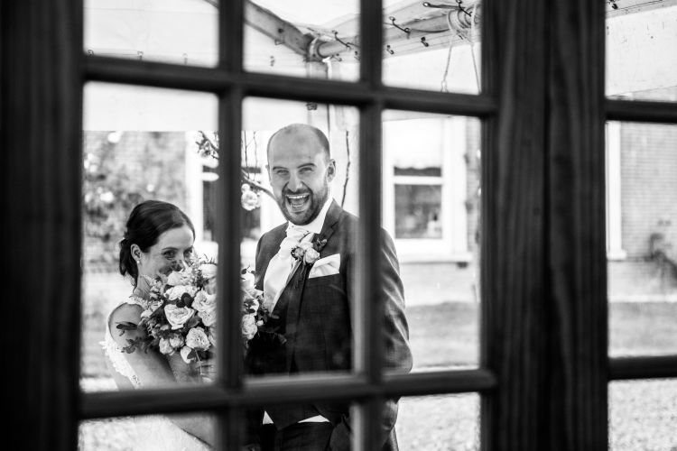 Bride and groom wait outside the Mount Ephraim Gardens in Kent