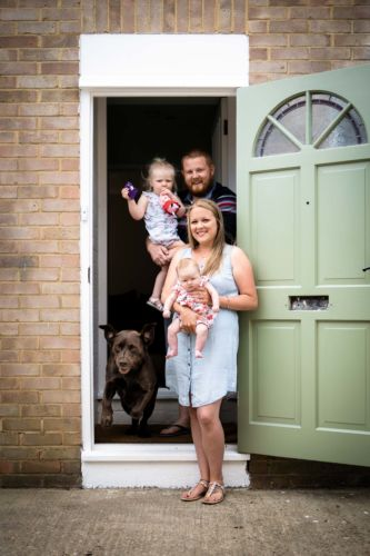 Family doorstep photoshoot with Mya the dog