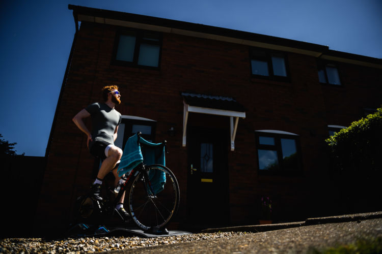 Doorstep Photoshoot of Will Gowers during lockdown riding his turbo trainer in the sun