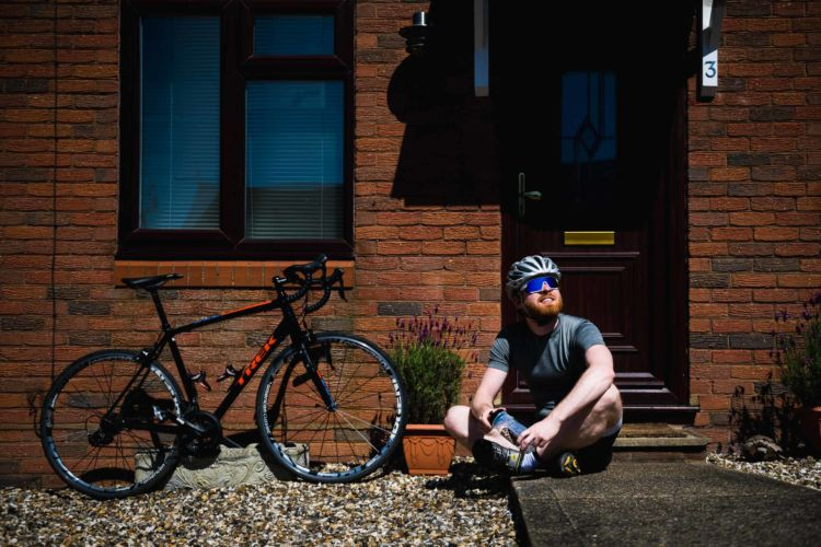 Doorstep portrait of Will Gowers during lockdown with his Bike